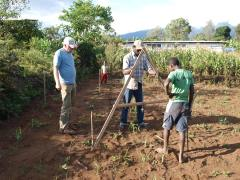 working with the A-Frame at smallscalefarm of Aloyce Massawe